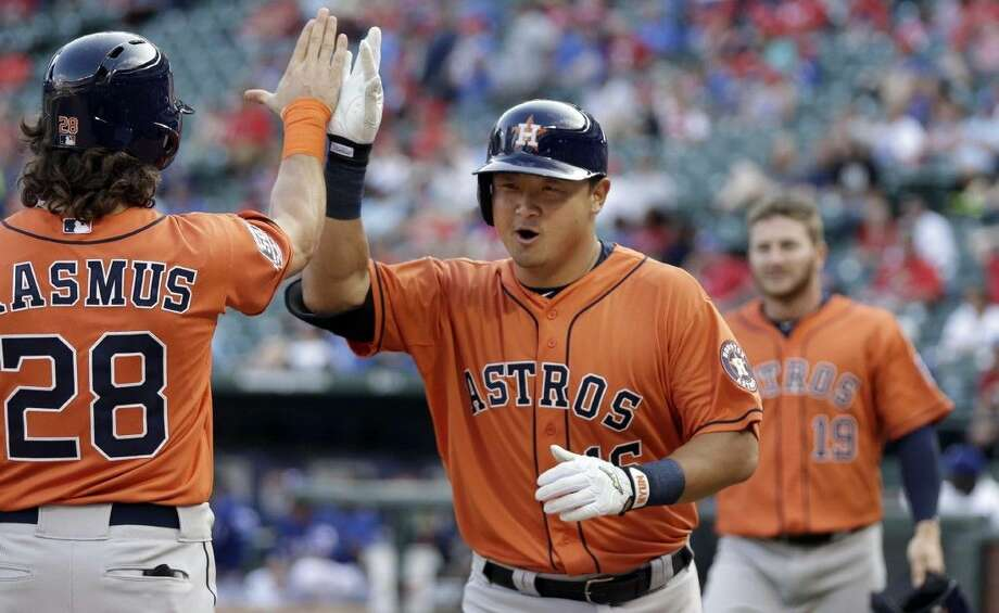 The Astros' Hank Conger celebrates his two-run home run with teammate Colby Rasmus.