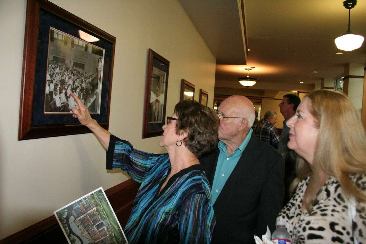 Bobbie and Jim Crain look at old photos at the newly opened Charles Bender Performing Arts Center April 11, 2015.