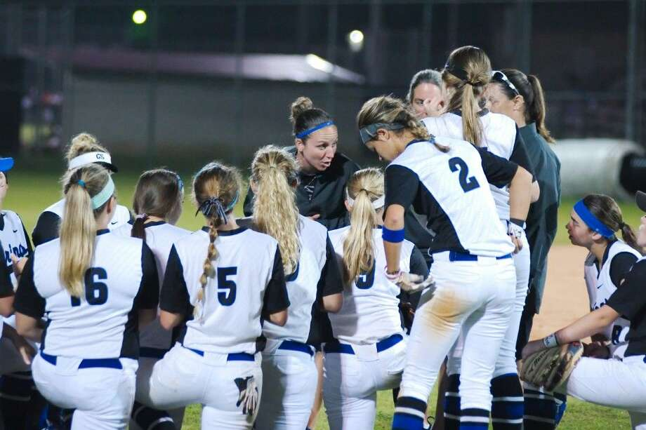Clear Springs softball coach Jennifer Knight speaks to her team after it defeated Friendswood Friday night to remain in contention for the District 24-6A title. Photo: KIRK SIDES