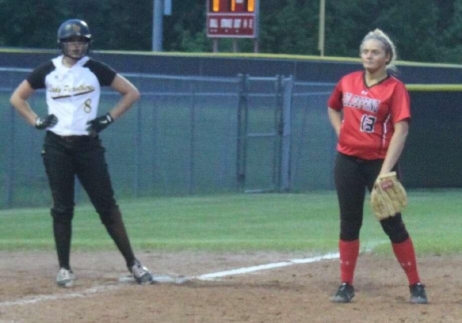 Kaitlyn Slack (8) sits on third base while Lady Trojan Katlyn Blalock (13) watches the action at the plate. Photo: Jacob McAdams
