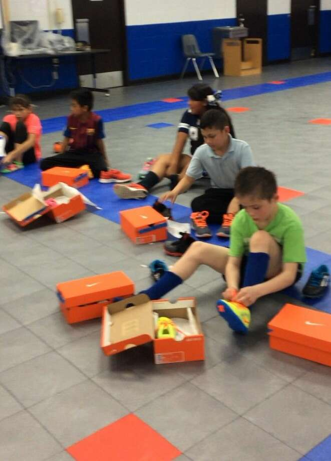 Bane students try on their new shoes, which were paid for by a matching CASE for Kids City Connections grant that CFISD' community programs department applied for.