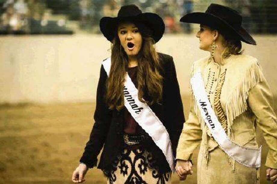 Savannah Martin reacts after being named Fair Queen while holding hands with fellow contestant Morgan Sanders during the crowning ceremony Saturday at the Lone Star Convention and Expo Center. Photo: Michael Minasi