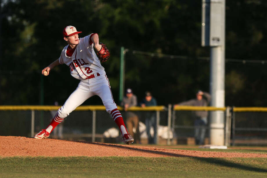 Tomball's Robby Vatuna (2) throws a pitch during the high school baseball game against Ridge Point on Tuesday, April 15, 2014, at Tomball High School. To view or purchase this photo and others like it, go to HCNPics.com. Photo: Michael Minasi
