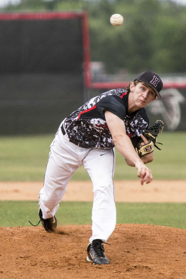 Huffman's Austin Smith pitches during Huffman's matchup against Hamshire Fannett on May 1, 2014, at Hargrave High School. Photo: ANDREW BUCKLEY