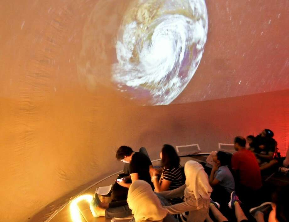 Students and community members enjoy the portable planetarium watching a short film on space exploration at NASA Space Science Day hosted by San Jacinto College. Photo credit: Andrea Vasquez, San Jacinto College marketing, public relations, and government affairs department.