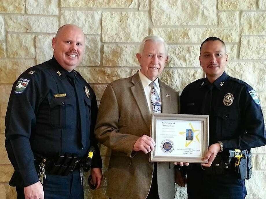Captain Chad Randall, Mayor Tom Reid and Officer Osiel De La Cruz.