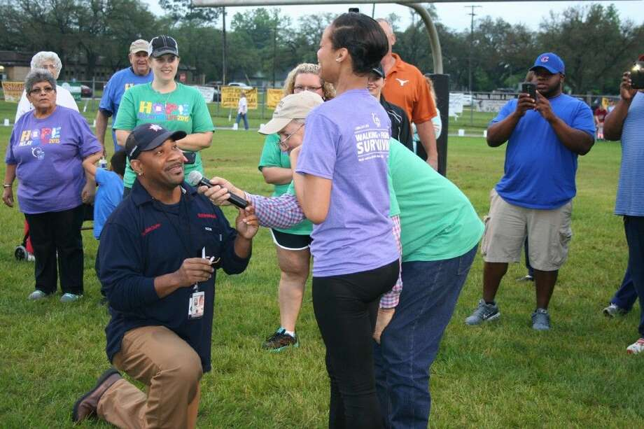 Rondale Durio proposes to his longtime girlfriend Alayna Arceneaux following the cancer survivors' lap at Relay for Life in Liberty on Friday, April 10. Alayna is currently battling ovarian cancer. The couple lives in Dayton with their son.