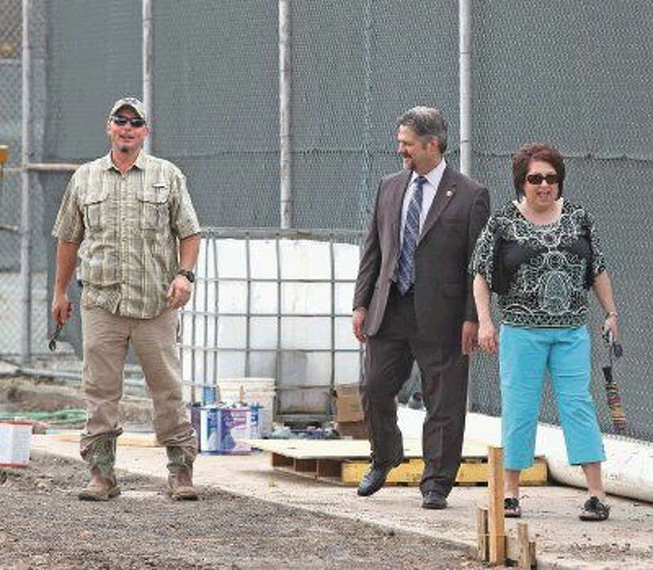 Mayor Jerry Mouton and his wife Tammie (pictured at right) check on the status of construction at the new 2,055 square-foot splash pad being built in Dow Park. Photo: Kar B Hlava