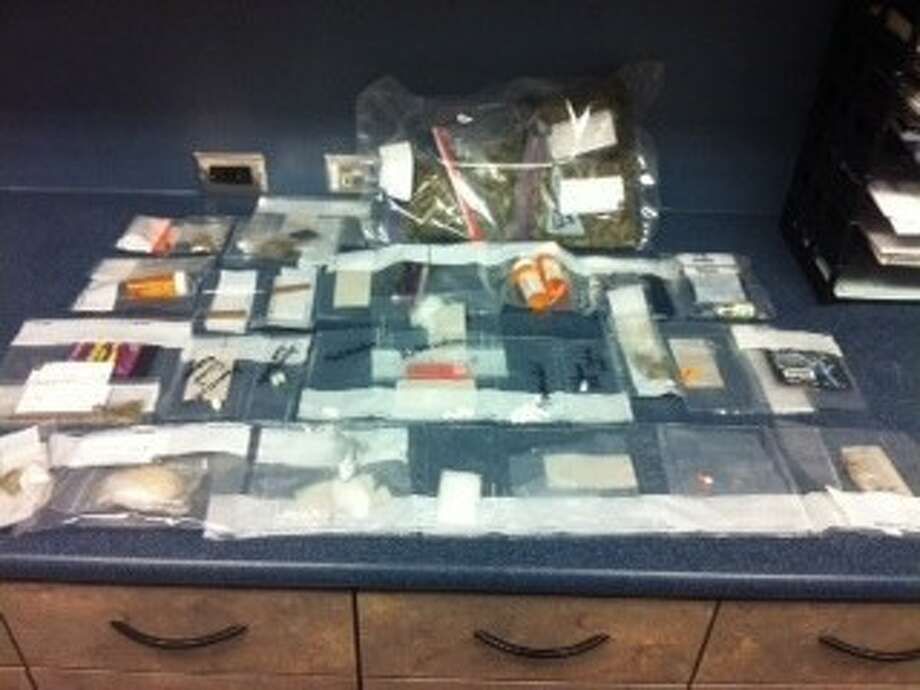 Deer Park Police collected 74.63 grams of methamphetamine, 10.5 grams of cocaine, 13 ounces of hydroponic marijuana, 32 ounces of hashish and one vial of testosterone from seven suspects that were arrested this month. Photo: Submitted Photo