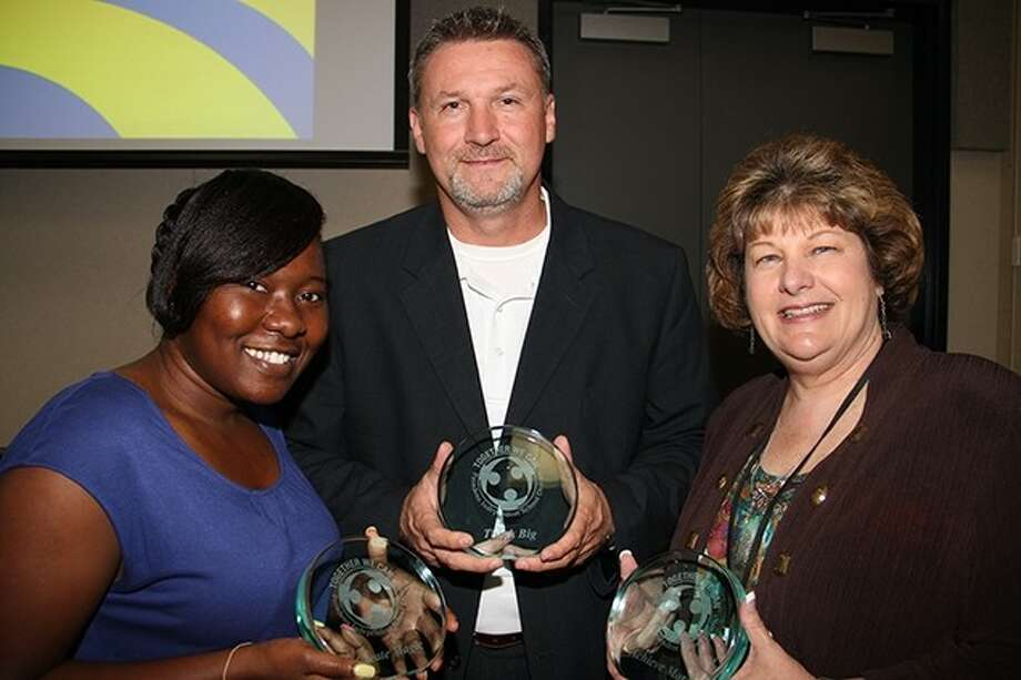 "Pictured (from left): Schneider Middle School teacher Uche Nwoke, Dobie High School principal Franklin Moses and the district's compliance monitoring director Joyce Boyd are named category winners at the Pasadena ISD ""Together We Can"" employee recognition luncheon. Photo: Courtesy Pasadena ISD"