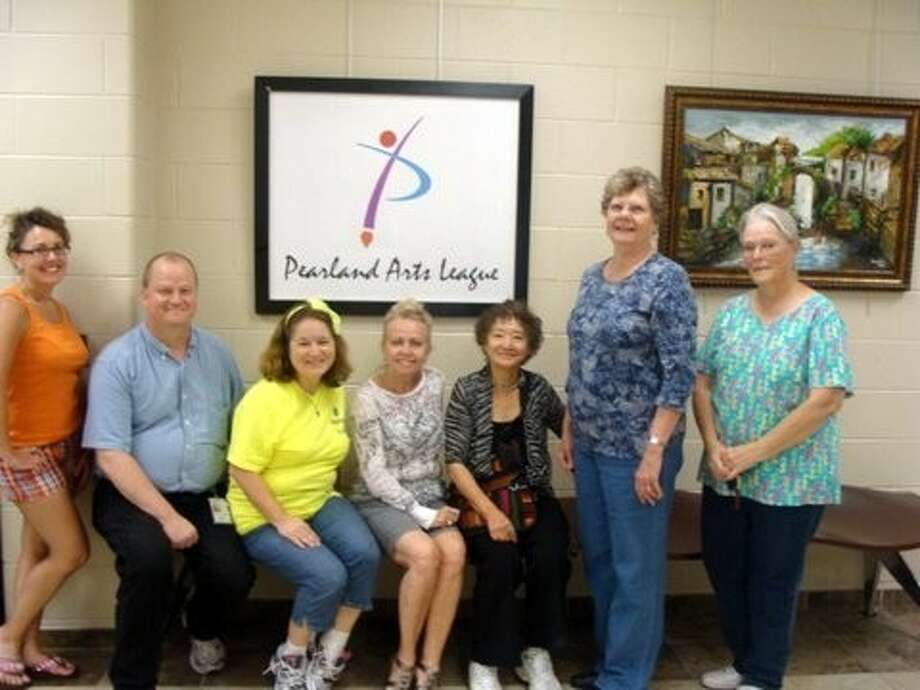 """Pearland Arts League members who are participating in the """"Art a la Carte"""" exhibition, which runs May 1-June 3, 2014 at Pearland Parks and Recreation second floor exhibition space 4141 Bailey Rd., included (left to right) Kelly Kronfeld, Michael Slattery, Liza Slattery, Naomi Stevens, Kim Jen, Margo Green and Sanddra Derrick. Photo: Picasa"""