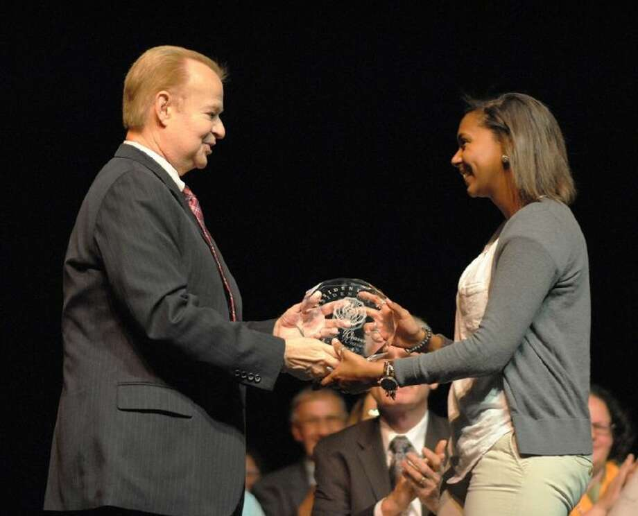 ACC President Dr. Rodney Allbright, left, presents student Krista Weaver with the President's Award during the Awards Day ceremony on April 28. Photo: Courtesy ACC