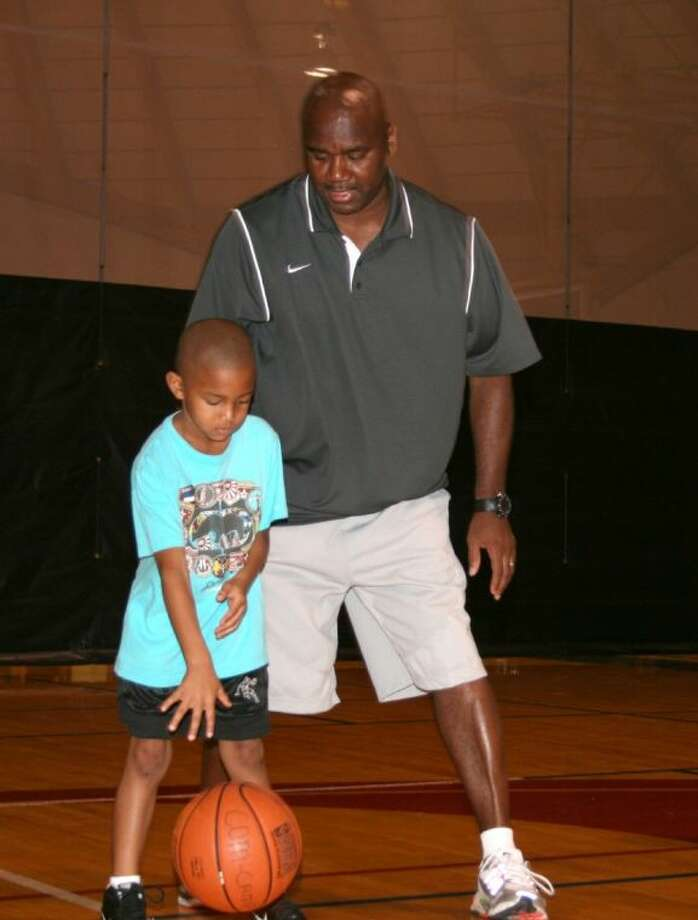A student gets a lesson in basketball fundamentals from Michael Richardson during College of the Mainland's basketball camp. This summer the college will offer again offer its popular basketball camp, plus volleyball and soccer camps.