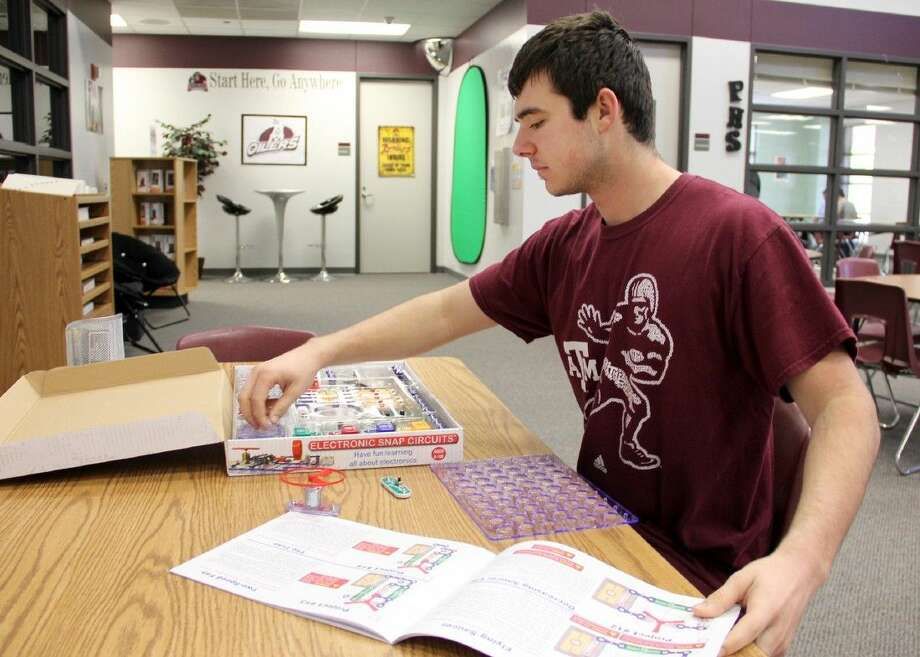 """Pearland High School student Jacob Madden explores electronic circuits in the Searcy Library """"Makerspace"""" -- an area that encourages student creativity and do-it-yourself learning."""