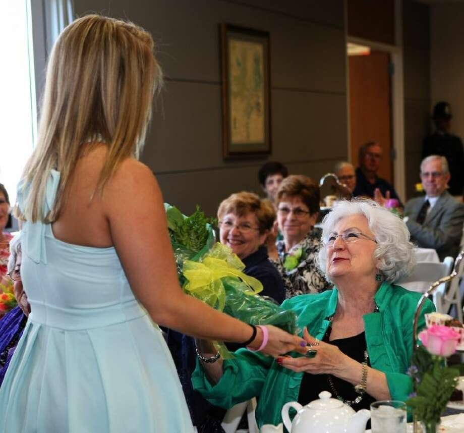 ACC Regent Brenda Brown, right, receives yellow roses during the President's Tea on April 29 in recognition of her time on the college board. Photo: Courtesy ACC