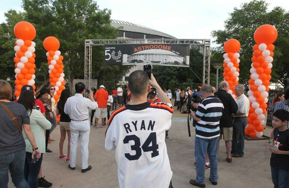 Fans look around outside the Astrodome during the 50th Birthday Party on April 9. To view or purchase this photo and others like it, go to HCNPics.com. Photo: Staff Photo By Alan Warren