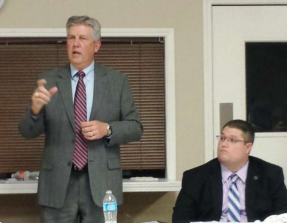Montgomery County Judge Craig Doyal, pictured with Jason Milsaps, speaks to a full house during Monday's forum held at First Baptist Church of Groceville to address a proposed $350 million road bond for the county.