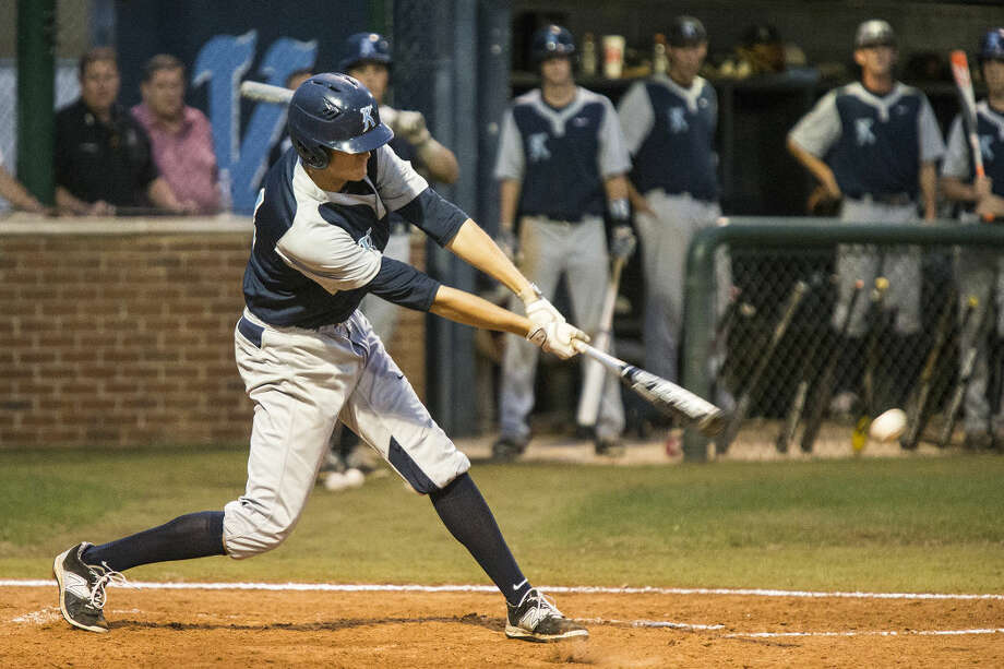 Kingwood's Travis French hits during Kingwood's matchup against Summer Creek on April 14, 2015, at Kingwood High School. Photo: ANDREW BUCKLEY