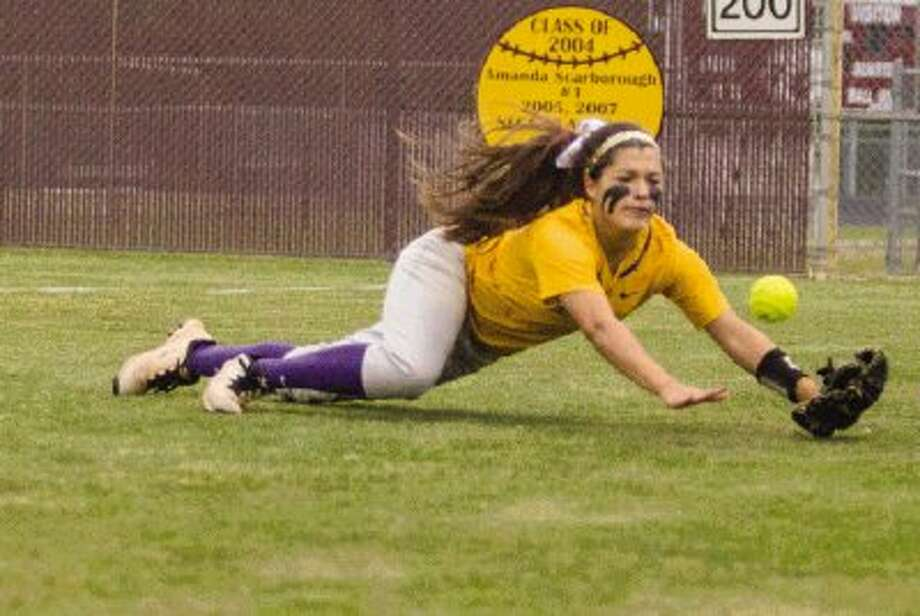 Montgomery's Jordan Berry dives for a fly ball in the Lady Bears' 5-4 victory over Magnolia. To view or purchase this photo and others like it, visit HCNpics.com.