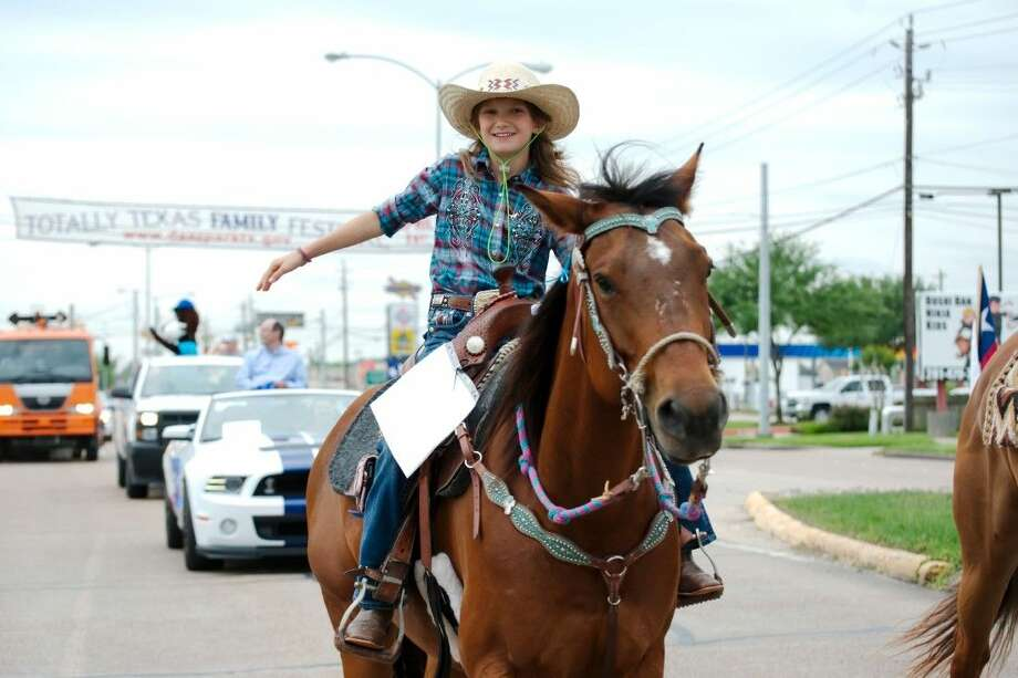 "A member of ""Those Lovely Ladies of Texas and Their Ponies"" riding team participates in the Deer Park Totally Texas Parade Saturday, April 11."