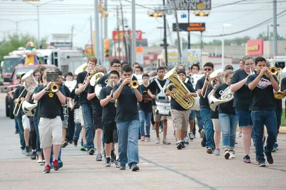 A band comprised of Deer Park ISD middle school and junior high bands marches in the Deer Park Totally Texas Parade Saturday.