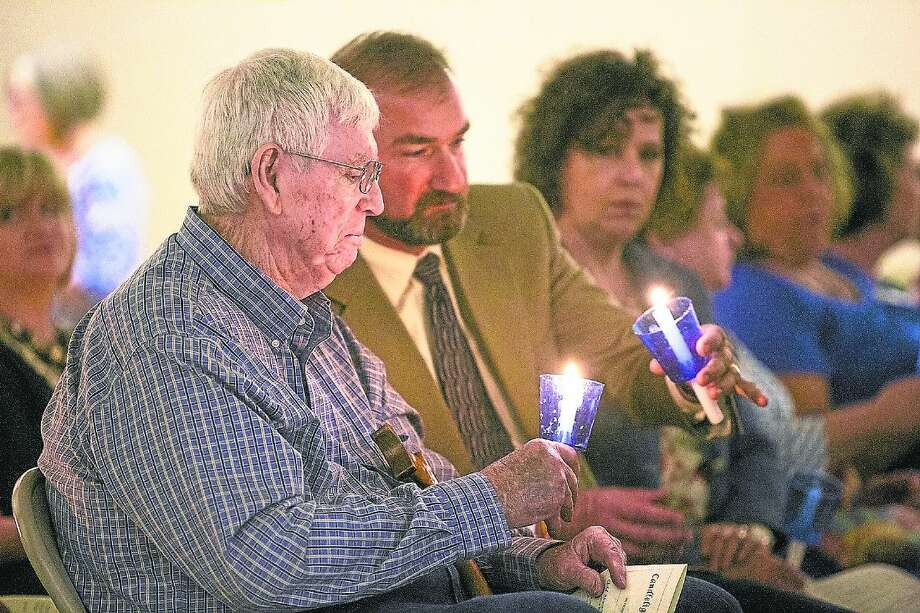 In this photo taken at last year's candlelight vigil for crime and child abuse victims, pictured are Tommy McMullan, left, and Liberty ISD Superintendent Cody Abshier. Photo: Andrew Buckley