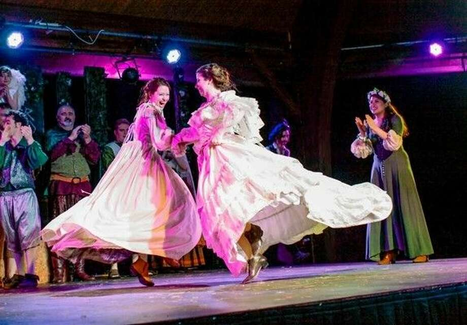 Rosalind, played by Haley Cameron, and Celia, played by Joanna Hubbard, dance to celebrate the four marriages in the Forest of Arden.