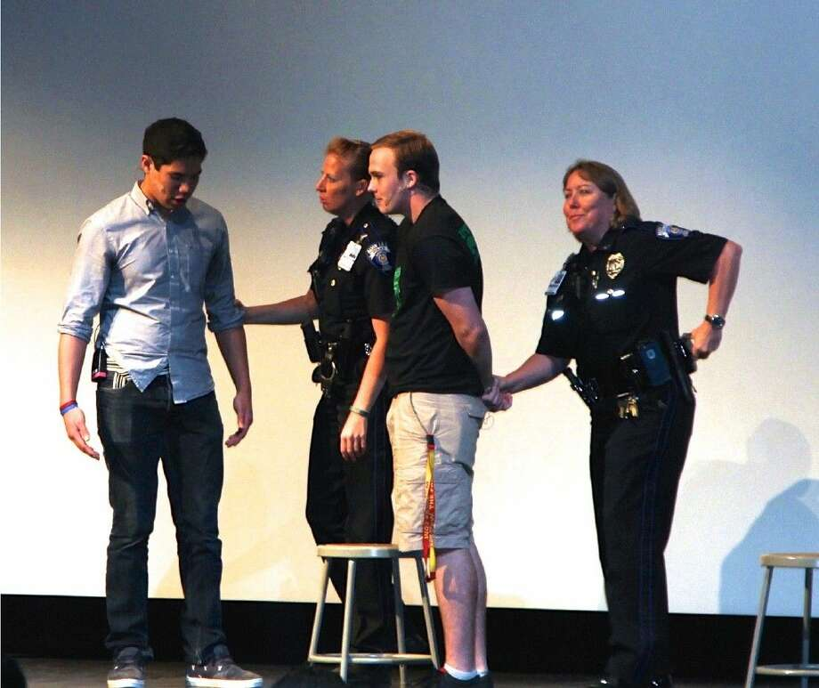 Alvin ISD Police Officers, Paula Parker and Teresa Garrett with Manvel High School Students during the skits performances.
