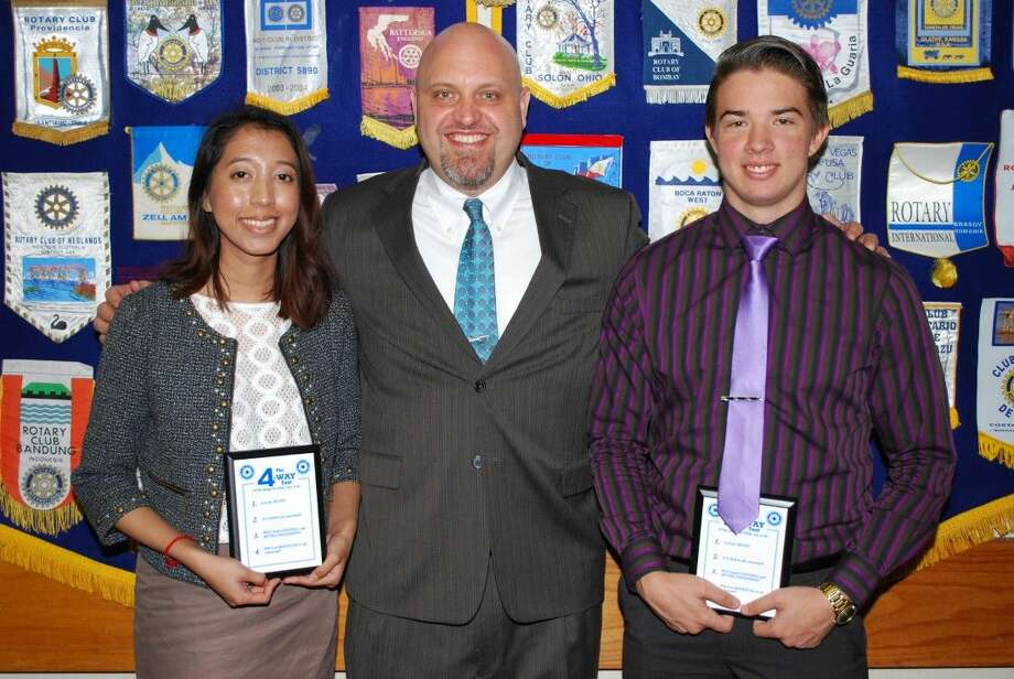 Pasadena Rotarians welcomed two Junior Rotarians from Memorial High School. Pictured with Assistant Principle John Thompson (C) are Alonda Romano (L) and Arrtoniu Claudiu Chioreanu (R).