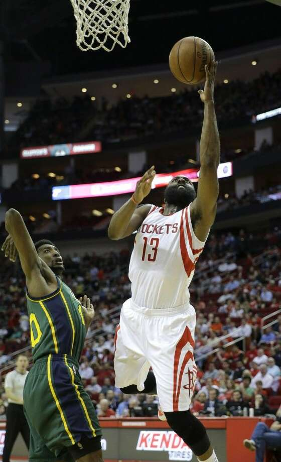 Houston Rockets' James Harden leans in for a layup against the Jazz Wednesday in Houston.