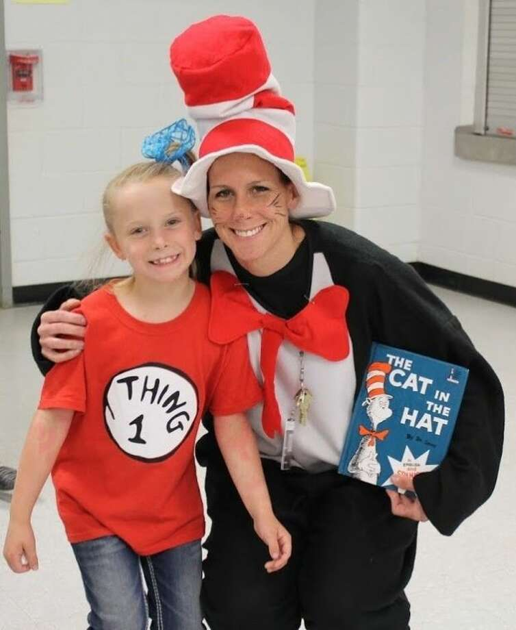 Second Grade Teacher Susan Cotton dressed as the Cat in the Hat with student Sophia Lee as Thing 1 for Everybody Reads Day at James Street Elementary on Thursday, May 1. Photo: JAMES SHUMAKE