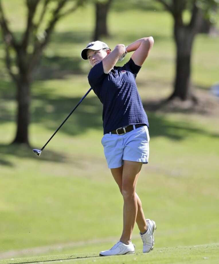 Stacy Lewis watches her approach shot on the 18th hole during the third round of the North Texas LPGA Shootout.