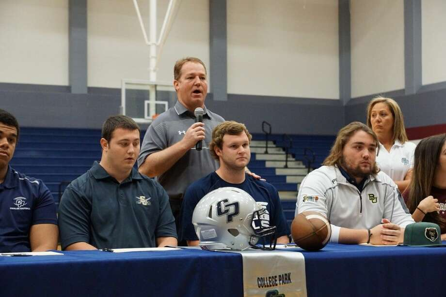 College Park football coach and campus athletic director Richard Carson speaks during a signing day ceremony on Wednesday.
