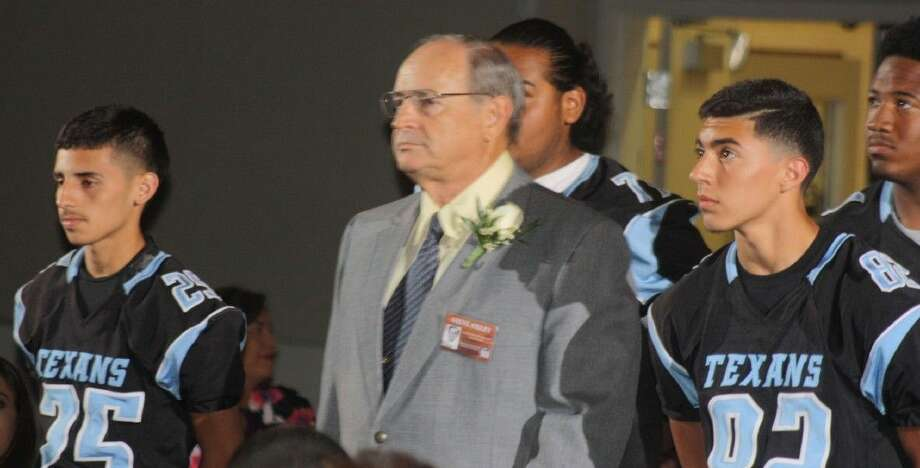 Inductee Steve Oxley, the former standout football player from Sam Rayburn in the late 1960s, is escorted down the red carpet by current Texans players during Saturday night's Hall of Fame Induction Banquet. Oxley earned all-state honors as both an offensive and defensive lineman. Then he lettered three seasons for the University of Texas. Photo: Robert Avery