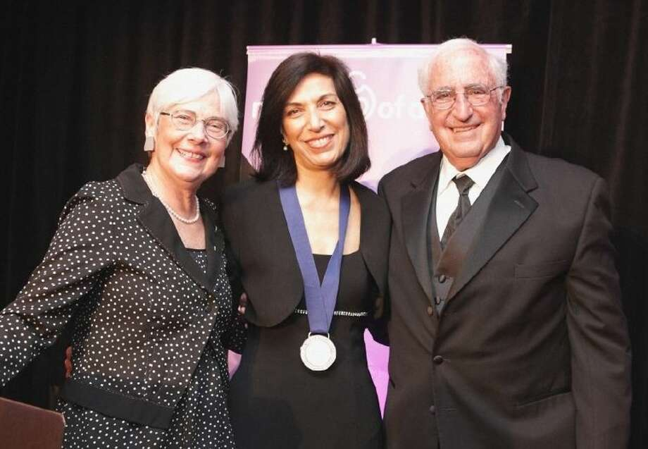Huda Y. Zoghbi, MD, center received the 2014 March of Dimes Prize in Developmental Biology at a gala event held May 5 in Vancouver, British Columbia. Dr. Zoghbi, who lives in West University Place, is director of the Jan and Dan Duncan Neurological Research Institute at Texas Children's Hospital, a professor at Baylor College of Medicine, and investigator at the Howard Hughes Medical Institute. Pictured with her at the gala are Dr. Jennifer L. Howse, left, president of the March of Dimes, and Dr. Joe Leigh Simpson, March of Dimes senior vice president for Research and Global Programs. Photo: David Ellingson