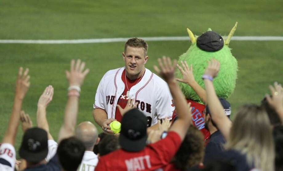 Houston Texans J. J. Watt looks in the crowd before giving away a signed ball Friday at the J. J. Watt Charity Classic softball game at Constellation Field. Photo: Alan Warren