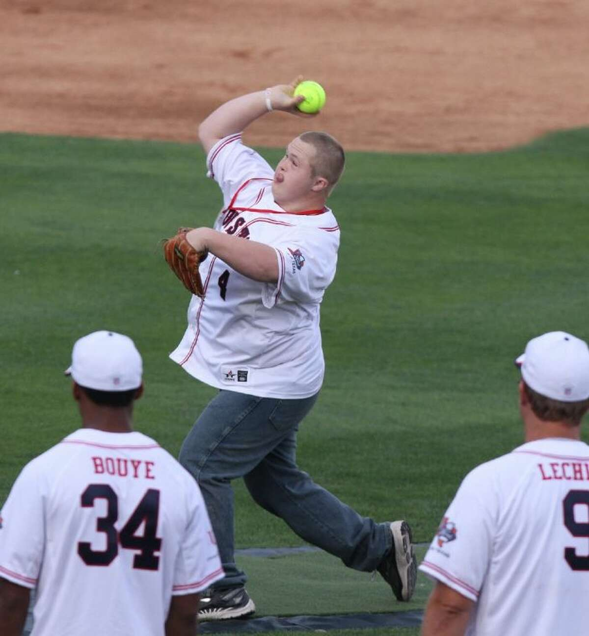 Houston Texans fan and friend of J. J. Watt Trey Brandt throws out the first pitch.