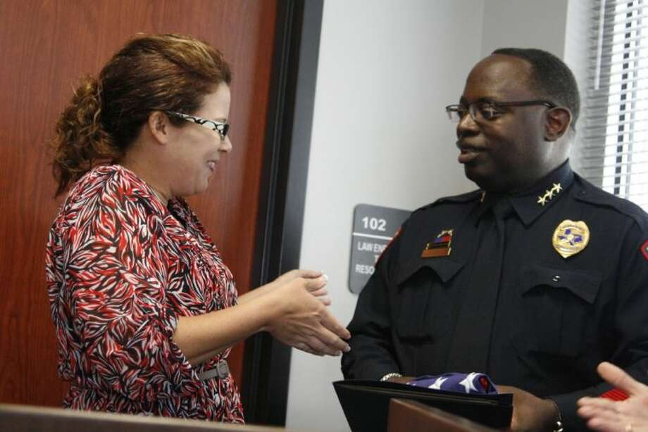 Kim Brode with U.S. Congressman Ted Poe's office presented Humble ISD Police Chief Solomon Cook with a flag flown over the Capitol at the 20th Anniversary celebration of the Humble ISD Police Department May 7, 2014.