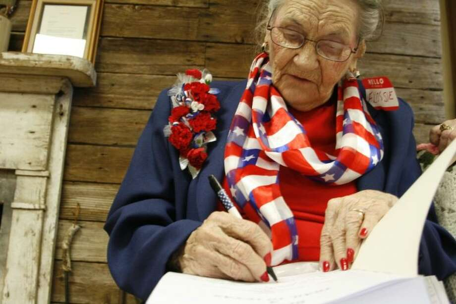 100-year-old Flossie Stanley Keels had the opportunity to sign a book containing some of her stories for her friends and family who were guests at her birthday party May 3, 2014.