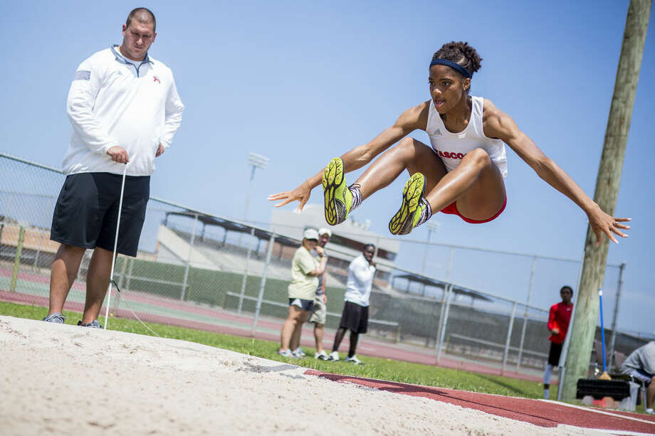 Atascocita's Taydria Nickerson leaps in the Triple Jump during the 16-6A District Track Meet on April 15, 2015, at Turner Stadium in Humble. Photo: ANDREW BUCKLEY