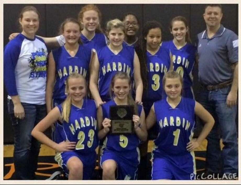 Hardin's district champions are, in back from left, Coach Kacee Peterson, Jenna Fregia, Laura Barrett, Maddie Moser, Jaylyn Davis, Kassidy Davie, Reilly Sanders, and Coach Robert Clark, and in the front, Carson Amyx, Jaci Stelly, and Karley Melancon. Photo: Submitted Image