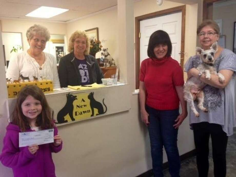 """Six-year-old Hailey Lanier sold handmade necklaces for $1 to family members, friends and even strangers and was able to raise more than $600 in two months to donate to A New Dawn Animal Shelter. Pictured front row from left: Hailey Lanier, Dawn Kubisz, volunteer Ann Penland holding """"Angel"""". Behind counter is Debbie Shumaker, volunteer Barbara Peters (volunteer) and shelter owner Dawn Kubisz. Photo: File Photo"""