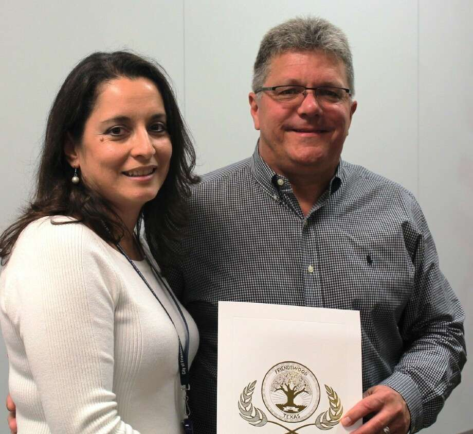 Friendswood Mayor Kevin Holland presents Friendswood Police Department Crime Victim Liaison Gina Mendez a proclamation in support of National Crime Victims' Rights Week, April 19-25. Photo: Jeff Newpher