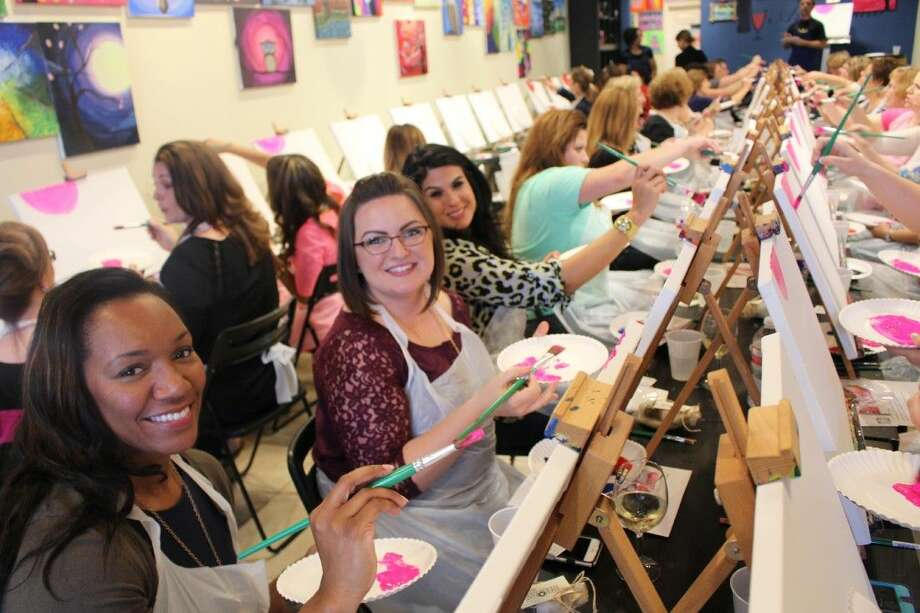 """(L to R) Roshanda Cayette-Contreras, Crystal Carbone and Claudia Garza enjoy a painting session during """"The Art of Knowing"""" event."""