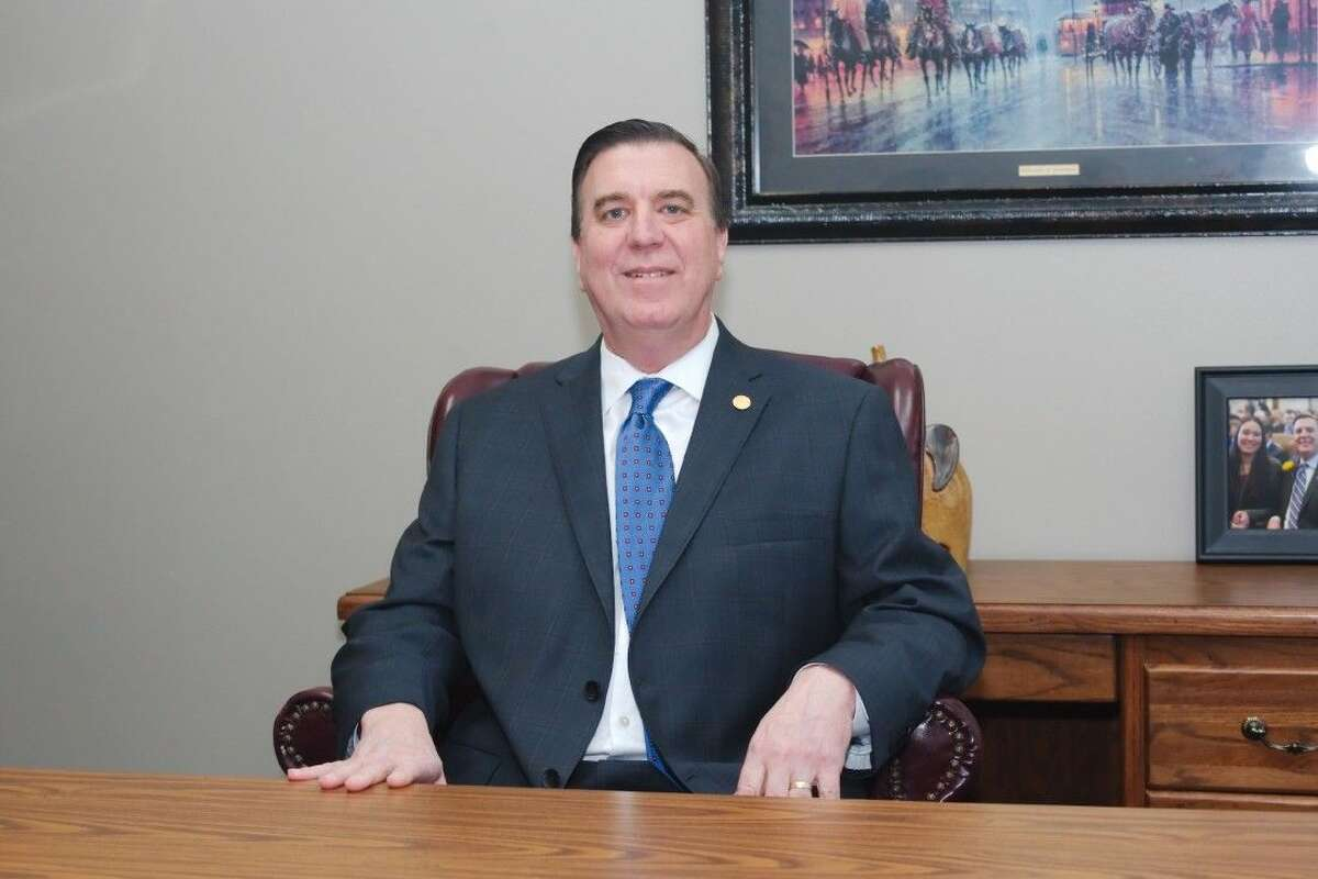 Texas Representative Dennis Paul sits at his desk in his new office on El Camino Real Friday.