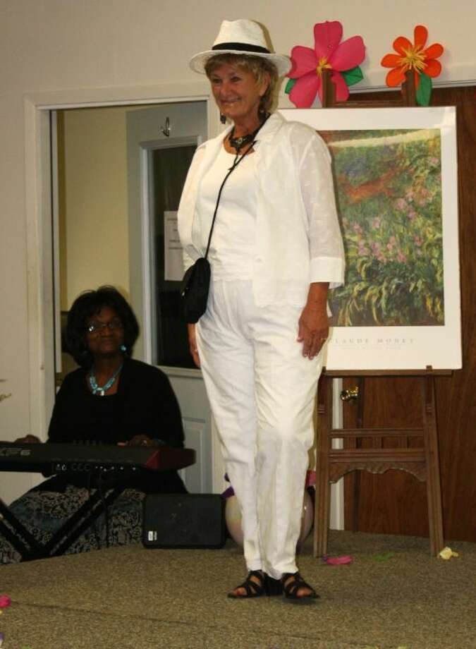 Diane Vinson shows off an all white outfit perfect for staying cool during the hot Texas summers. Vinson was one of the models at the style show hosted at the Senior Citizens Center in Coldspring on Saturday, May 3. Photo: RACHEL HALL
