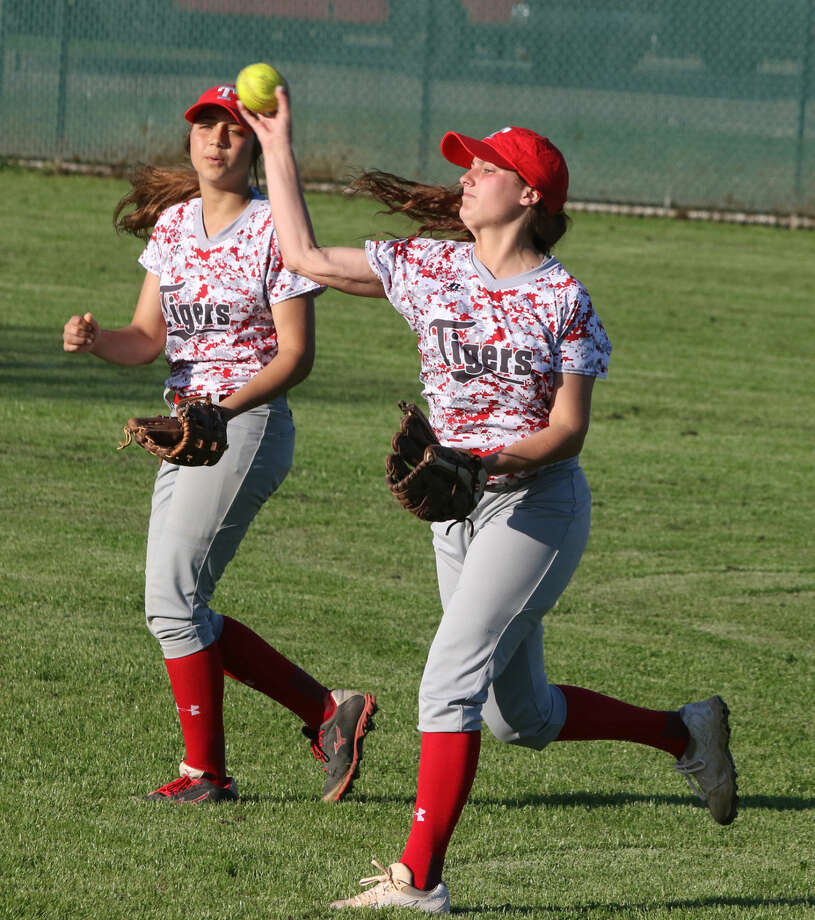 Travis' Rylee Taylor fires a throw into the infield against Dulles during their March 24 district softball game at Travis High School in Richmond. The Lady Tigers are tied with Dulles and Clements for first place at 11-2. Photo: Staff Photo By Alan Warren