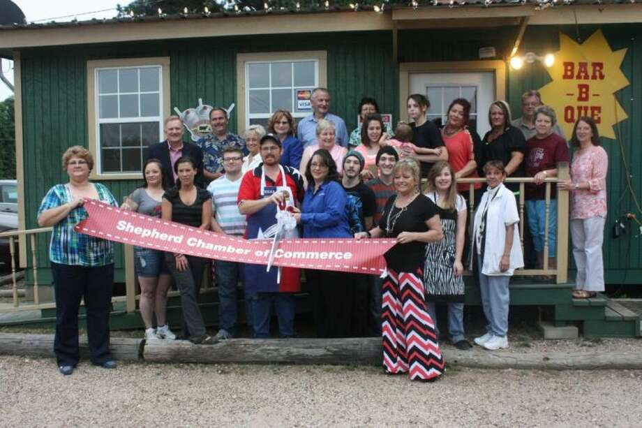 William LaCoste, his staff, family, friends and both chambers gathered together for the Shepherd Chamber of Commerce ribbon cutting. Photo: JACOB MCADAMS