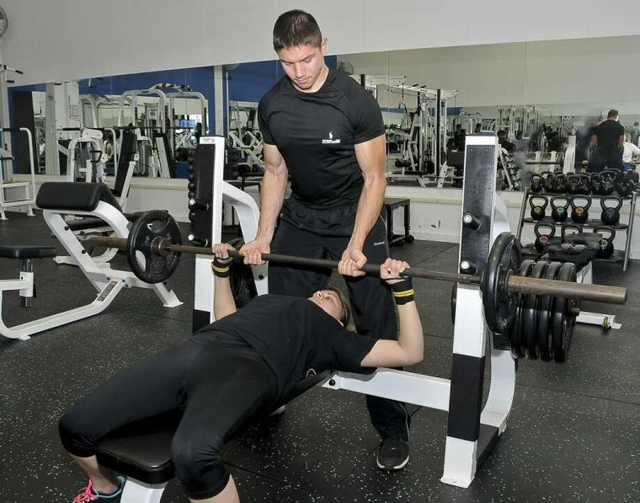 Beginning Fall 2014, San Jacinto College will offer a new personal trainer program. Pictured: Michael Rodriguez and Meagan Snyder. Photo credit: Andrea Vasquez, San Jacinto College marketing, public relations, and government affairs department.