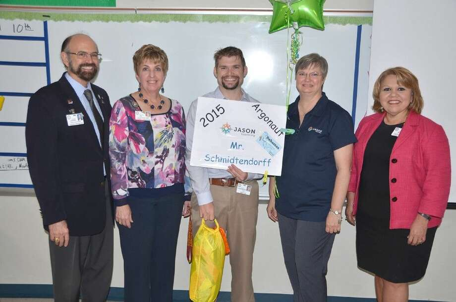CFISD Board and staff members celebrate Arnold Middle School teacher Adam Schmidtendorff's selection as a 2015 JASON Educator Argonaut. Pictured (L-R) are Tom Jackson, Board of Trustees vice president; Debra Hill, coordinator of secondary science; Adam Schmidtendorff, Arnold seventh- and eighth-grade science teacher; Monica Schmidt, coordinator for elementary science, grades 2-6; and Dr. Linda Macias, associate superintendent of curriculum and instruction and accountability.